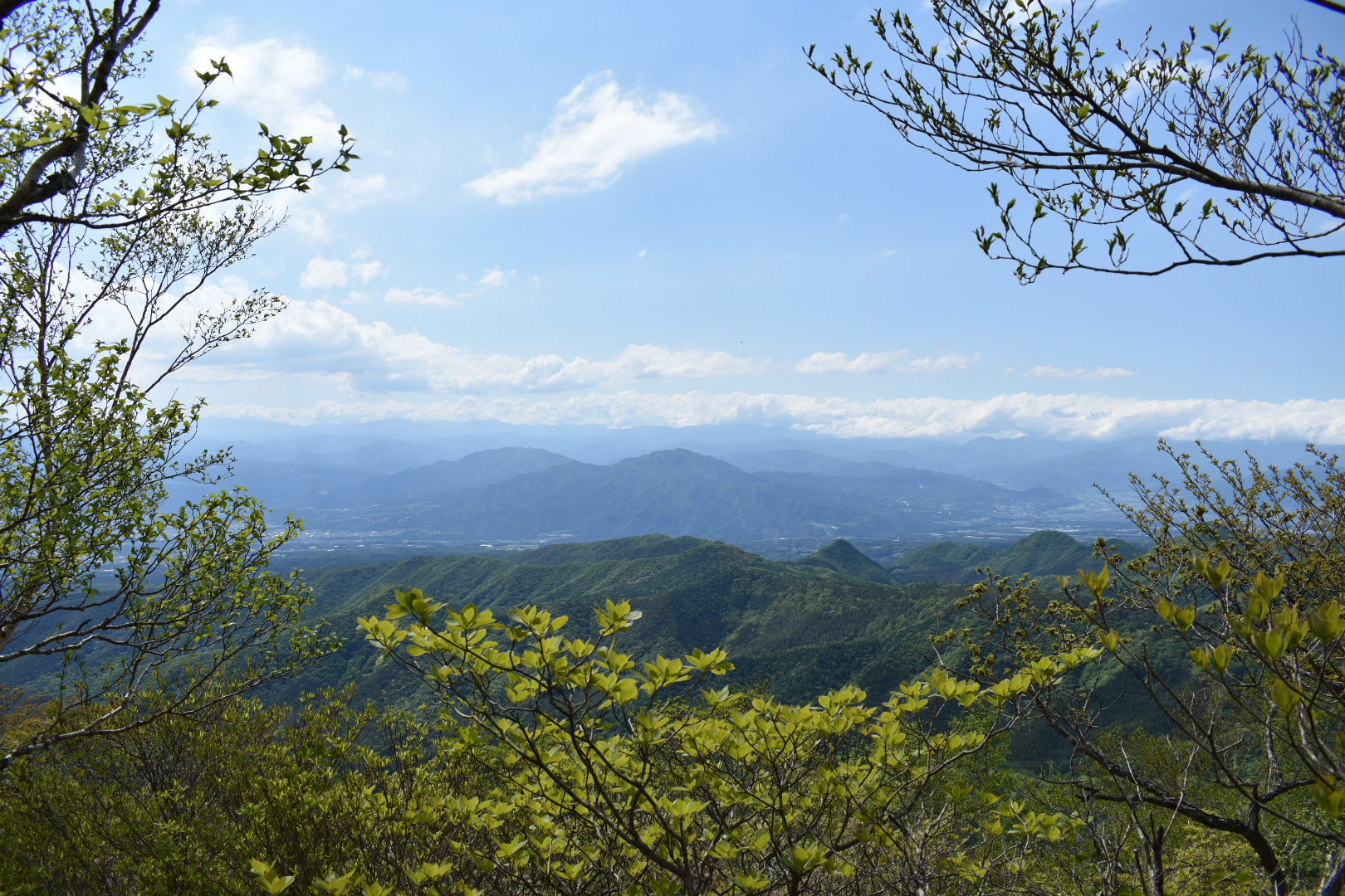 A view from Arayama Peak of blue mountains stretching out in the distance