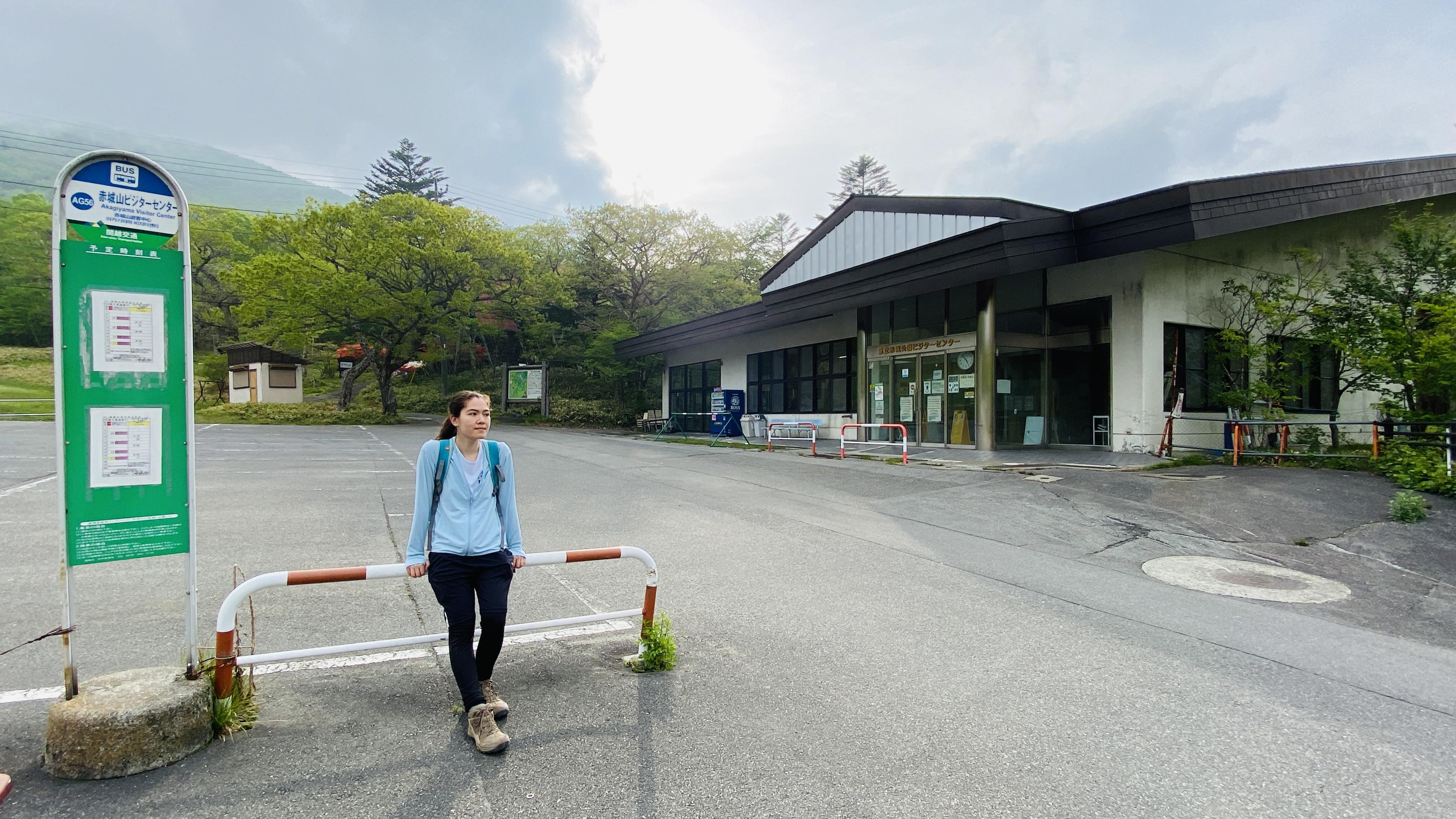 hiker waits at bus stop next to Akagi visitor center